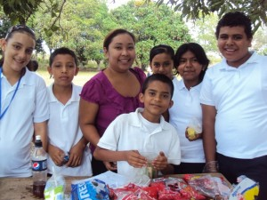 Asuncion Garcia, business teacher, with 7th grade entrepreneurs selling snacks during recess to fellow students